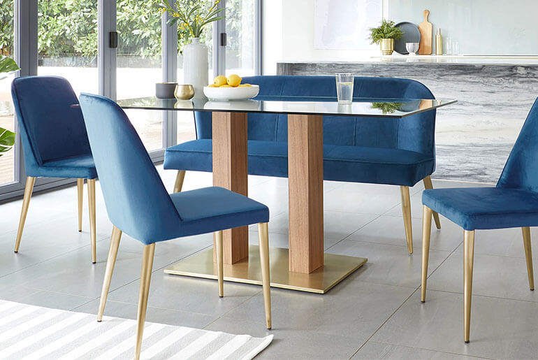 blue velvet dining chair and rectangular glass table