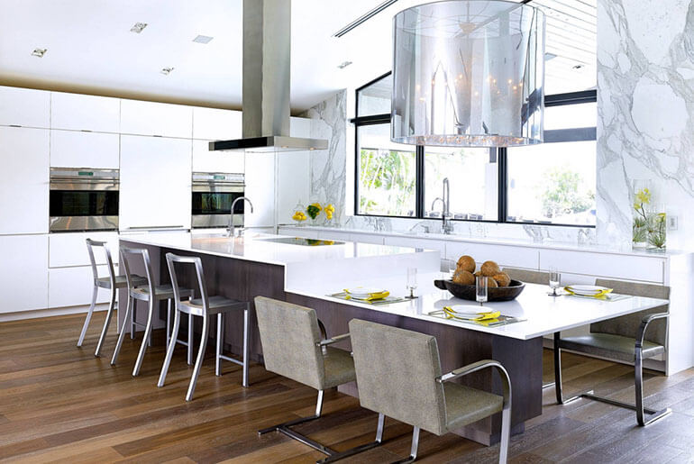 mismatched bar stools and kitchen chairs